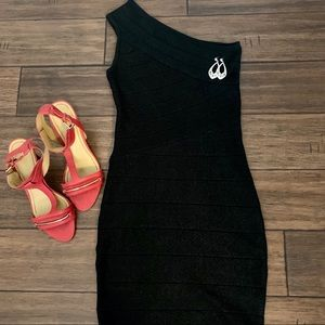 Black sparkly bodycon dress.